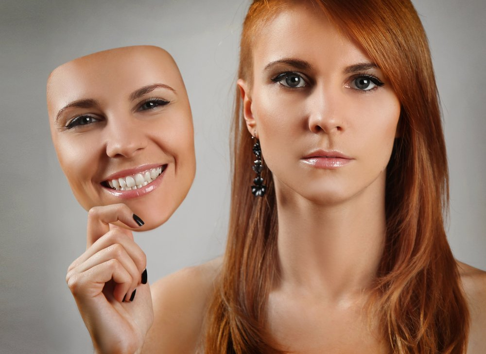 Woman Holding Realistic Mask Next to Face